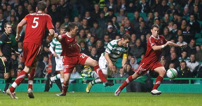 Shaun Maloney goes down in the box for another penalty kick to round off the action