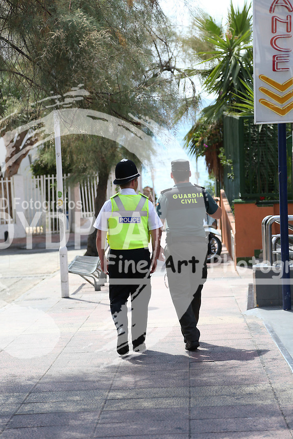 **ALL ROUND PICTURES FROM SOLARPIX.COM**<br /> **WORLDWIDE SYNDICATION RIGHTS**<br /> **NO SYNDICATION IN SPAIN**<br /> Caption:<br /> British police have flown out  two British police officers to Magaluf to help the local Police force deal with UK nationals involved in crime.Two officers from the West Midlands force will patrol alongside the Guardia Civil in Magaluf, on the island of Mallorca to assist in investigations where British holidaymakers are offenders or victims.The British ambassador to Spain, Simon Manley, said: &ldquo;The presence of UK police officers will help to remind British holidaymakers of the importance of respecting local laws and customs, ensuring that everyone has a safe and enjoyable holiday, free from trouble and crime.&rdquo;The  British uniformed Officers are  spending the first week in Magaluf before heading to San Antonio for another week in what is being described as a trial operation. <br /> This pic:British Police alongside the Spanish Civil Guard in Magaluf today.<br /> JOB REF:18543   MJS     DATE:10.08.2015<br /> **MUST CREDIT SOLARPIX.COM OR DOUBLE FEE WILL BE CHARGED**<br /> **MUST NOTIFY SOLARPIX OF ONLINE USAGE**<br /> **CALL US ON: +34 952 811 768 or LOW RATE FROM UK 0844 617 7637**
