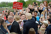 United States President Donald Trump greets guests during the annual Easter Egg Roll on the South Lawn of the White House  in Washington, DC, on April 17, 2017. <br /> Credit: Olivier Douliery / Pool via CNP