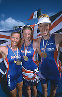 10 NOV 2002 - CANCUN, MEXICO - Elite Womens World Champion Leanda Cave (GBR) flanked by Womens Bronze medallist Michelle Dillon (GBR) and Mens Bronze medallist Andrew Johns (GBR) at the ITU World Championships. (PHOTO (C) NIGEL FARROW)