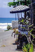 Bali, Badung, Kuta. A small shrine with offerings close to the beach.