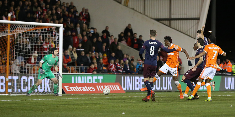 Blackpool's Armand Gnanduillet beats Arsenal's Aaron Ramsey to the ball only to see Petr Cech safely gather<br /> <br /> Photographer Stephen White/CameraSport<br /> <br /> Emirates FA Cup Third Round - Blackpool v Arsenal - Saturday 5th January 2019 - Bloomfield Road - Blackpool<br />  <br /> World Copyright © 2019 CameraSport. All rights reserved. 43 Linden Ave. Countesthorpe. Leicester. England. LE8 5PG - Tel: +44 (0) 116 277 4147 - admin@camerasport.com - www.camerasport.com