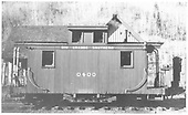 RGS caboose #0400 in front of Telluride section house.<br /> RGS  Telluride, CO  Taken by Laube, Winfield G. - 6/30/1949