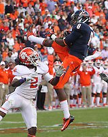 Virginia safety Anthony Harris (8) intercepts the ball from Clemson wide receiver Sammy Watkins (2) during the game Saturday at Scott Stadium in Charlottesville, VA. Clemson defeated Virginia 59-10.  Photo/Andrew Shurtleff