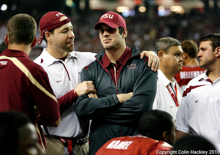 ATLANTA, AG 12/31/10-FSU-SC FB10 CH-Florida State Assistant Strength and Conditioning Coach Eric Korem, left, takjs with Christian Ponder after Ponder was taken out of the Chick-fil-A Bowl against South Carolina with a concussion. The Seminoles beat the Gamecocks 26-17...COLIN HACKLEY PHOTO