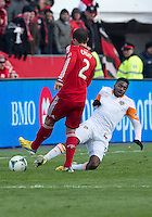 20 April 2013: Houston Dynamo defender Warren Creavalle #5 goes in hard on Toronto FC defender Logan Emory #2 during the second half in an MLS game between the Houston Dynamo and Toronto FC at BMO Field in Toronto, Ontario Canada..Logan Emroy had to leave the game with a leg injury..The game ended in a 1-1 draw...