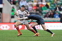Justin Douglas of Canada is tackled by Franco Sabato of Argentina during Day Two of the iRB Marriott London Sevens at Twickenham on Sunday 11th May 2014 (Photo by Rob Munro)