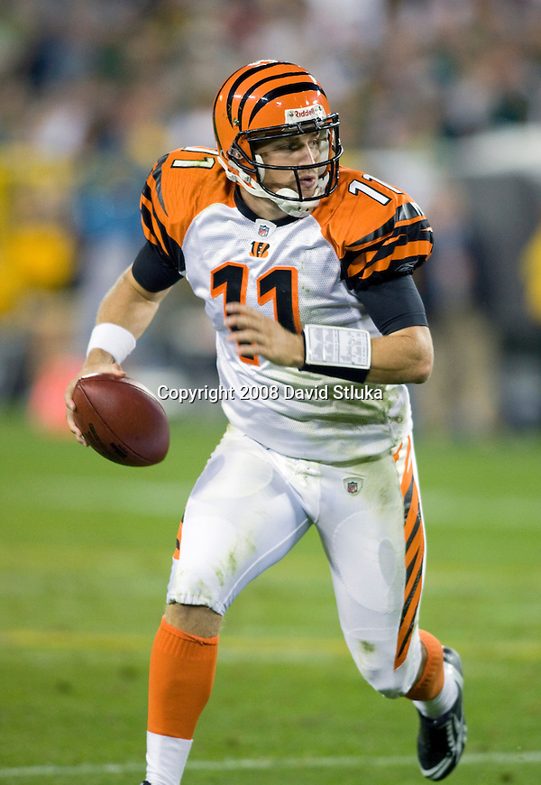 Quarterback Ryan Fitzpatrick #11 of the Cincinnati Bengals rolls out of the pocket against the Green Bay Packers at Lambeau Field on August 11, 2008 in Green Bay, Wisconsin. The Bengals beat the Packers 20-17. (AP Photo/David Stluka)