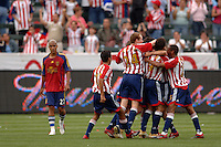 CD Chivas players jump on teammate Francisco Gomez after scoring a goal against Real Salt Lake in the first half at the Home Depot Center in Carson, CA on Saturday night, April 2, 2006. (Matt A. Brown/ISI).(Matt A. Brown/ISI)