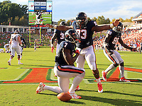 Virginia wide receiver Ben Hogg (83) reacts to a fumble recovery for a touchdown by Virginia defensive end Eli Harold (7) in the third quarter of the game Saturday Sept. 6, 2014 at Scott Stadium in Charlottesville, VA. Virginia defeated Richmond 45-13. Photo/Andrew Shurtleff