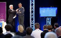 30 MAY 2012 - LONDON, GBR - Commentator Paul Bray (left) asks Great Britain Men's coach Dragan Djukic for his choice of group for the host nation's men's team during the London 2012 Olympic Games Handball Draw at the National Sports Centre in Crystal Palace, Great Britain (PHOTO (C) 2012 NIGEL FARROW)