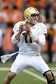 Boston College Eagles quarterback Chase Rettig (11) looks to pass during a game against the Syracuse Orange at the Carrier Dome on November 30, 2013 in Syracuse, New York.  Syracuse defeated Boston College 34-31.  (Copyright Mike Janes Photography)