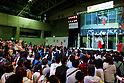 "People look at the singers at the Niconico Douga fan event at Makuhari Messe International Exhibition Hall on April 25, 2015, Chiba, Japan. The event includes special attractions such as J-pop concerts, Sumo and Pro Wrestling matches, cosplay and manga and various robot performances and is broadcast live on via the video-sharing site. Niconico Douga (in English ""Smiley, Smiley Video"") is one of Japan's biggest video community sites where users can upload, view, share videos and write comments directly in real time, creating a sense of a shared watching. According to the organizers more than 200,000 viewers for two days will see the event by internet. The popular event is held in all 11 halls of the huge Makuhari Messe exhibition center from April 25 to 26. (Photo by Rodrigo Reyes Marin/AFLO)"