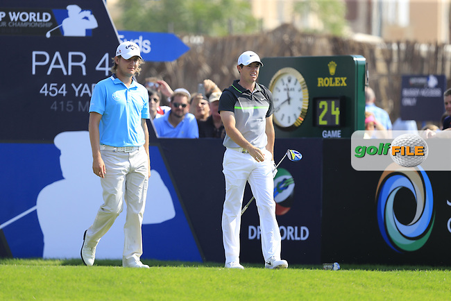 Emiliano Grillo (ARG) and Rory McIlroy (NIR) on the 1st tee during Round 2 of the DP World Tour Championship at the Earth course,  Jumeirah Golf Estates in Dubai, UAE,  20/11/2015.<br /> Picture: Golffile | Thos Caffrey<br /> <br /> All photo usage must carry mandatory copyright credit (&copy; Golffile | Thos Caffrey)