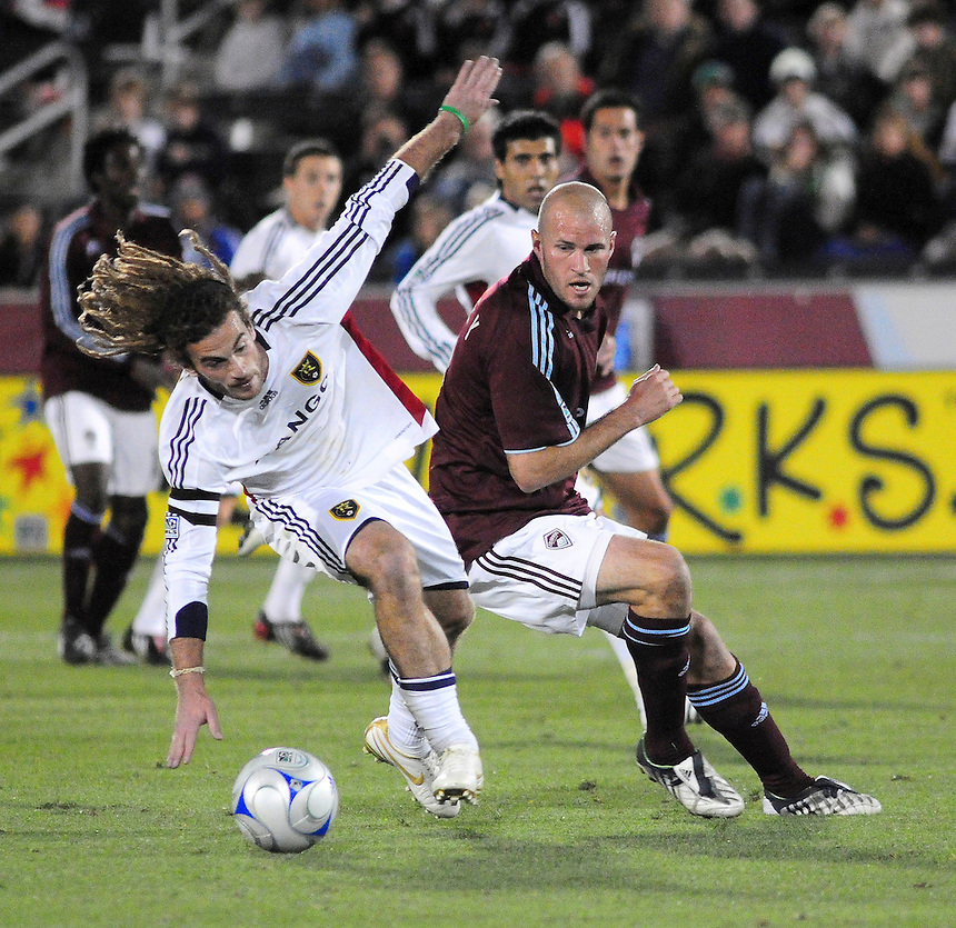 25 October 08: Real Salt Lake midfielder Kyle Beckerman (in white) and Rapids forward Conor Casey. Real Salt Lake tied the Colorado Rapids 1-1 at Dick's Sporting Goods Park in Commerce City, Colorado. The tie advanced Real Salt Lake to the playoffs.