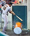 1 July 2011: San Francisco Giants' pitchers Brian Wilson (38) beats a Gatorade cooler he had chucked in the dugout with a bat, after being pulled in the ninth inning of the San Francisco Giants at Detroit Tigers Major League Baseball game at Comerica Park, in Detroit, Michigan. The Giants won 4-3.