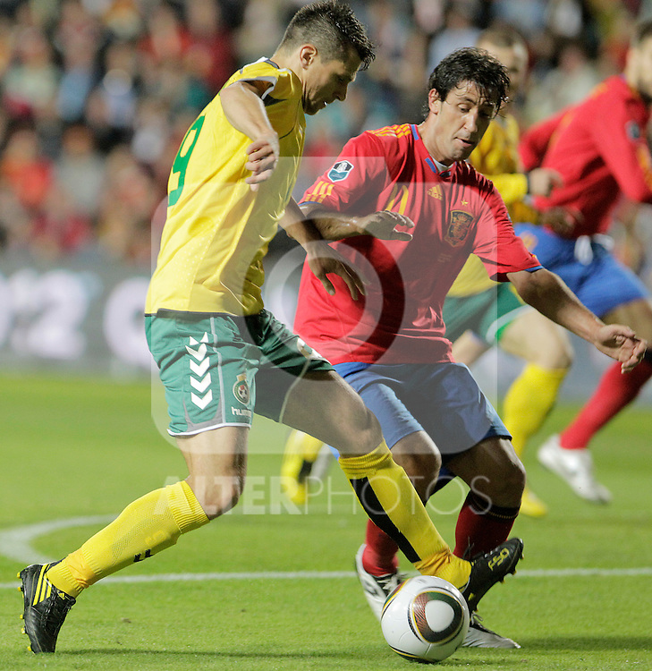 Lithuania's Tomas Danilevicius (l) and Spain's Joan Capdevila during UEFA Eurocup 2012 qualifying match.October 8,2010. (ALTERPHOTOS/Acero)