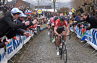 Tiesj Benoot (BEL/Lotto-Soudal) enduring a beer spray while leading the favorites bunch up the Oude Kwaremont<br /> <br /> 102nd Ronde van Vlaanderen 2018 (1.UWT)<br /> Antwerpen - Oudenaarde (BEL): 265km