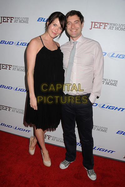 """Katie Aselton, Mark Duplass.""""Jeff, Who Lives At Home"""" Los Angeles Premiere held at the Directors Guild of America, West Hollywood, California, USA..March 7th, 2012.full length dress black pregnant couple trousers pink shirt grey gray tie.CAP/ADM/BP.©Byron Purvis/AdMedia/Capital Pictures."""