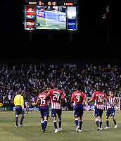 Chivas USA forward Ante Razov (9) and  teammates watch the big screen reply of him scoring a goal. Chivas USA and the LA Galaxy played to a  1-1 draw at Home Depot Center stadium, in Carson, California on Thursday, July 10, 2008.