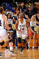 28 January 2012:  FIU guard Kamika Idom (14) handles the ball in the first half as the FIU Golden Panthers defeated the Western Kentucky University Hilltoppers, 60-56, at the U.S. Century Bank Arena in Miami, Florida.