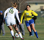 SIOUX FALLS, SD - NOVEMBER 7:  Brittany Jensen #14 from SDSU looks to make a move past Natalie Fenske #16 from NDSU in the second half of the Summit League Championship Soccer match Saturday at Fischback Soccer Field in Brookings. (Photo by Dave Eggen/Inertia)