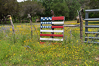 Somewhere in the Texas Hill country we came across this field of mostly yellow wildflowers with this red, white and blue flag painted on the boards to represent the flag leaning against this bob wire fence. To make it more interesting old boots were place on the cedar post.  Just another Texas scene along the back rosd of the Hill Country.