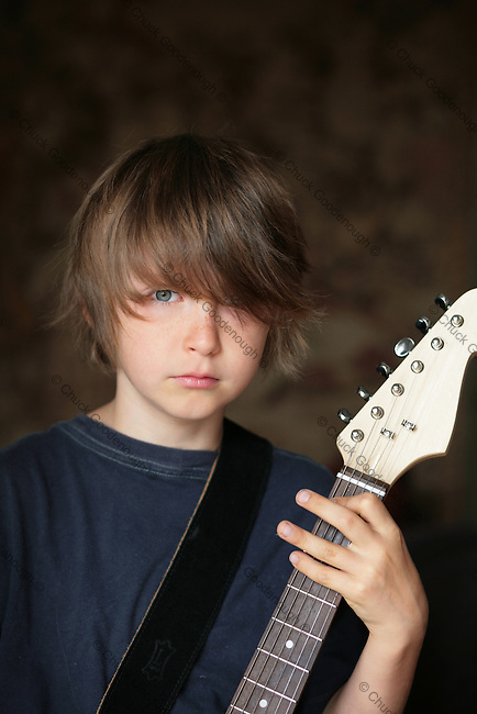 Stock Photo of a Little Rock and Roll Boy With His Freckles and Guitar