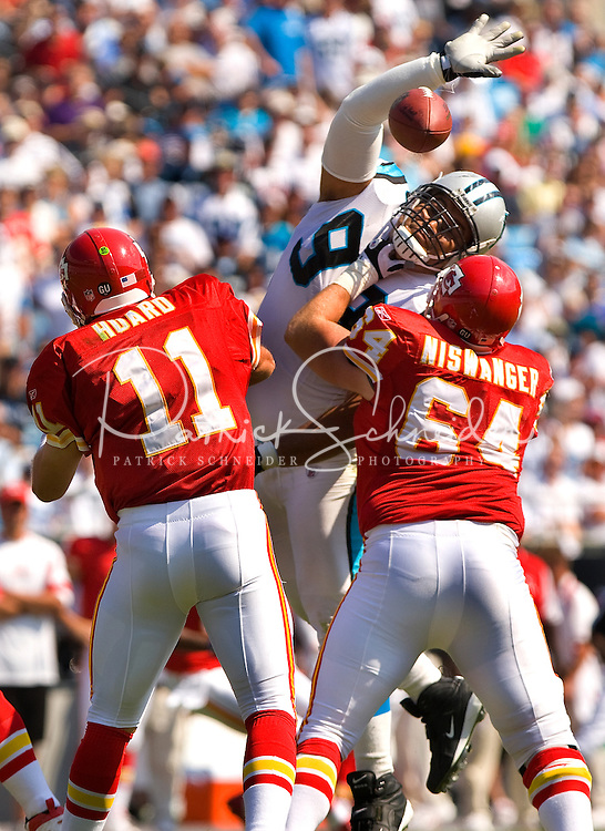 Carolina Panthers defensive tackle Maake Kemoeatu (99) tires to knock down a pass from Kansas City Chiefs quarterback Damon Huard (11) during a NFL football game at Bank of America Stadium in Charlotte, NC.