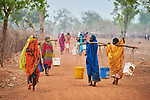 Women carry water in the Kaya Refugee Camp in Maban County, South Sudan. The camp shelters thousands of refugees from the Blue Nile region of Sudan, and Jesuit Refugee Service, with support from Misean Cara, provides educational and psycho-social services to both refugees and the host community.