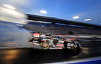 Oct. 31, 2008; Las Vegas, NV, USA: NHRA funny car driver John Force does a burnout during qualifying for the Las Vegas Nationals at The Strip in Las Vegas. Mandatory Credit: Mark J. Rebilas-