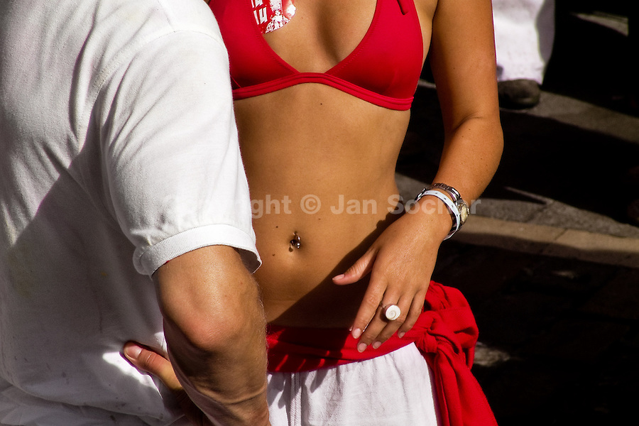 A boy with a girl wearing traditional red and white colours during the San Fermín festival in Pamplona, Spain, 6 July 2005.