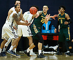RAPID CITY, SD: DECEMBER 1:  Tyler Oliver #23 of Black Hills State passes as he meet defenders from South Dakota Mines during their Rocky Mountain Athletic Conference men's basketball game Saturday evening at the King Center Rapid City, S.D.  (Photo by Richard Carlson/dakotapress.org)