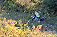 ATV's riding through Perch Creek. Fall landscape, wildflowers at  Perch Creek Nature Habitat and at the Blackwell landfill site.