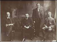 BNPS.co.uk (01202 558833)<br /> Pic: Nestle/BNPS<br /> <br /> John Mackintosh the 'Toffee King' pictured centre sitting with his son Harold standing next to him.<br /> <br /> An original member of the Quality Street lineup has made way for a new chocolate after 80 years. <br /> <br /> The Toffee Deluxe was created in 1919 as a sweet in its own right and was included in the first ever box of Quality Street when it was invented in 1936.<br /> <br /> The stalwart, that has a brown wrapper, has now bitten the dust and has been ditched in favour of the new 'Honeycomb Crunch' sweet.