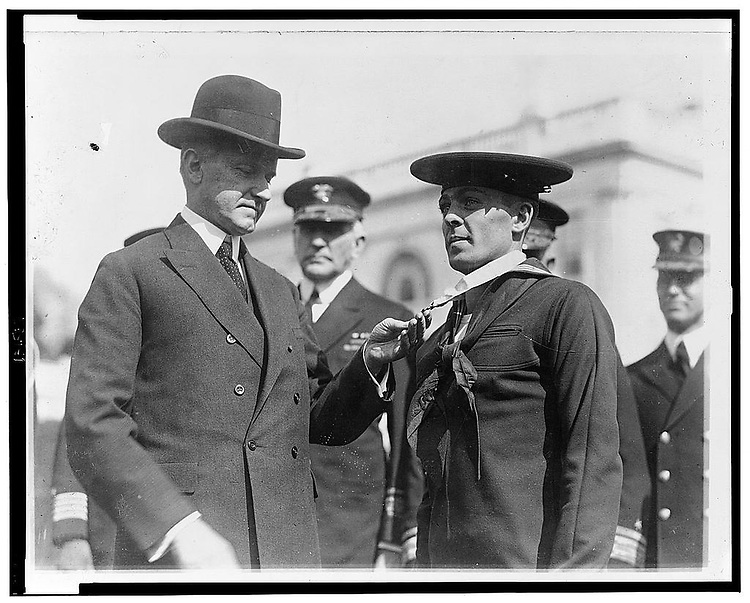 "UNITED STATES - FILE PHOTO: President Coolidge] decorating Henry Breault of the submarine 0-5 with the Congressional Medal of Honor.On October 28, 1923 Torpedoman Second Class Breault was a member of the crew of USS O-5 when that submarine was sunk in a collision in the Panama Canal. Though he could have escaped, Breault chose to assist a shipmate, and remained inside the sunken submarine until both were rescued more than a day later. For his ""heroism and devotion to duty"" on this occasion, Henry Breault was awarded the Medal of Honor. He received his Medal of Honor from President Calvin Coolidge, in ceremonies at the White House, Washington, D.C., on March 8, 1924. Following twenty years of U.S. Navy service, Henry Breault became ill with a heart condition. . (Photo By Douglas Graham/Roll Call)"