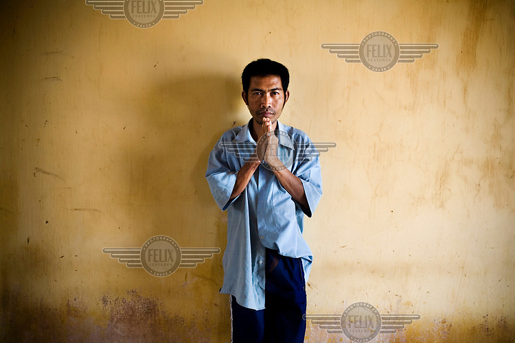 A man at a Ministry of Social Affairs-run mental health facility near the capital.<br /> <br /> Only one percent of the Cambodian government's health budget goes to mental health services and only 0.1 percent of the population have access to these services.