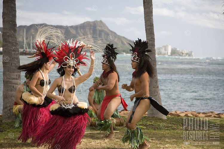 Polynesian dancers dancing at Magic Island with Diamond Head in the background