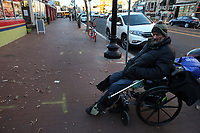 (171128RREI2307)  Carlos Munoz, wheel chair bound, at La Esquina where Latinos have gathered for decades at the corner of Mt. Pleasant St. and Kenyon St. NW. to play checkers (damas). Washington DC.  Nov. 28 ,2017 . ©  Rick Reinhard  2017     email   rick@rickreinhard.com
