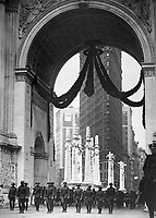 Col. Donovan and staff of 165th Inf., passing under the Victory Arch, N.Y.C. 1919. Paul Thompson. (War Dept.)<br />