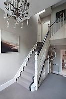 Grey tones continue from the entance hall up the staircases to the landings