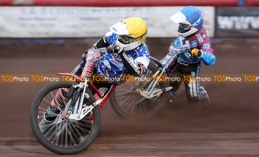Heat 2: Kyle Howarth (yellow) and Robert Mear (blue) - Lakeside Hammers v Poole Pirates, Elite League Speedway at the Arena Essex Raceway, Pufleet - 04/05/12 - MANDATORY CREDIT: Rob Newell/TGSPHOTO - Self billing applies where appropriate - 0845 094 6026 - contact@tgsphoto.co.uk - NO UNPAID USE..