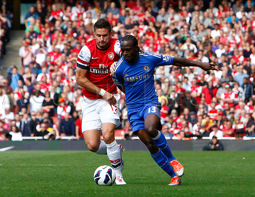 29.09.2012. North London, England. ..Olivier Giroud of Arsenal and Victor Moses of Chelsea..Barclays Premier League. Arsenal versus Chelsea.