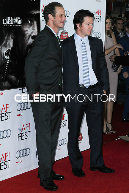 "HOLLYWOOD, CA - NOVEMBER 12: Peter Berg, Mark Wahlberg at the AFI FEST 2013 - ""Lone Survivor"" Premiere held at TCL Chinese Theatre on November 12, 2013 in Hollywood, California. (Photo by David Acosta/Celebrity Monitor)"
