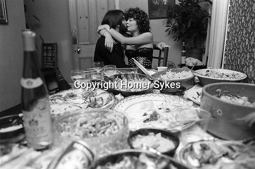 Middle class party Wimbledon London 1983.  Couple kissing 1980s Britain.