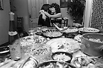 Middle class party Wimbledon London 1983.  Couple kissing 1980s Britain.