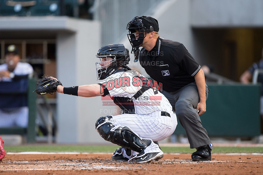 Charlotte Knights catcher Brett Hayes (2) sets a target as home plate umpire Chris Segal looks on during the game against the Lehigh Valley Iron Pigs at BB&T BallPark on June 3, 2016 in Charlotte, North Carolina.  The Iron Pigs defeated the Knights 6-4.  (Brian Westerholt/Four Seam Images)