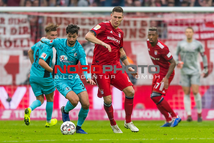 03.11.2018, Allianz Arena, Muenchen, GER, 1.FBL,  FC Bayern Muenchen vs. SC Freiburg, DFL regulations prohibit any use of photographs as image sequences and/or quasi-video, im Bild Tim Kleindienst (Freiburg #34) mit Niklas Suele (FCB #4) <br /> <br />  Foto © nordphoto / Straubmeier
