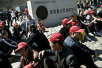 Tourists and tour groups gather outside the Badaling tourist area of the Great Wall outside Beijing, China.
