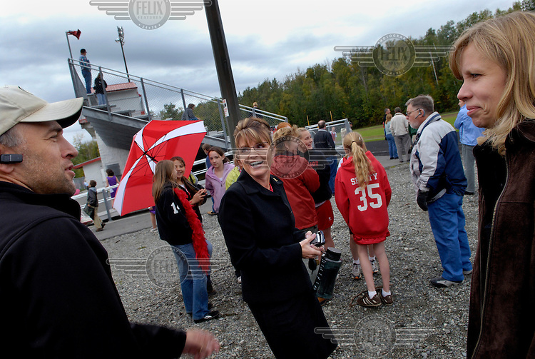 Sarah Palin, Governor of Alaska, chats with other parents at a cross country run competition in which her daughter Willow was taking part. In 2008 she was nominated as the Republican candidate for Vice President.